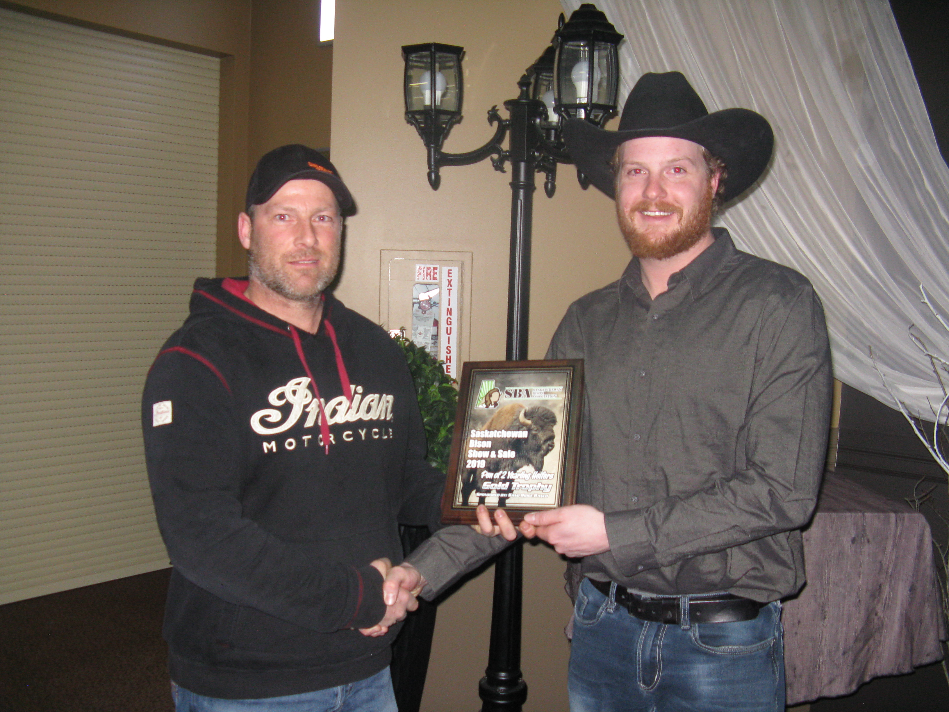 Sand Ridge presents to Roaming K Pen of 2 Yearling Heifers - Gold